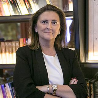 Dña. María Torres Rey